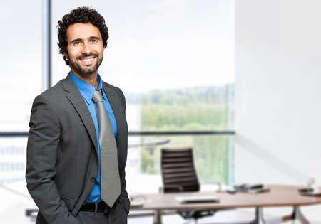 latin man: Smiling businessman Stock Photo