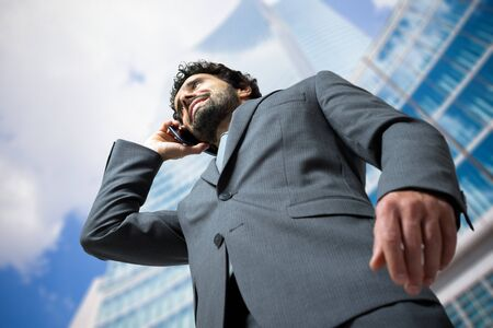 low perspective: Portrait of a businessman talking on the phone. Low perspective Stock Photo
