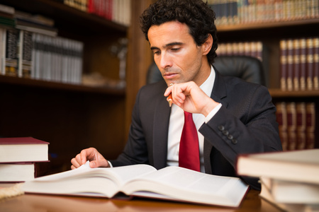 Portrait of a businessman reading a book