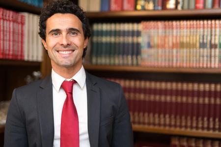 director de escuela: retrato abogado sonriente en su estudio
