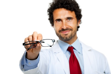 shortsighted: Young doctor giving you a pair of eyeglasses Stock Photo