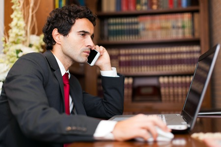 telephone call: Portrait of an handsome businessman talking on the phone