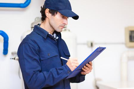 service man: Plumber at work Stock Photo