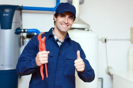 clipboard: Plumber at work Stock Photo