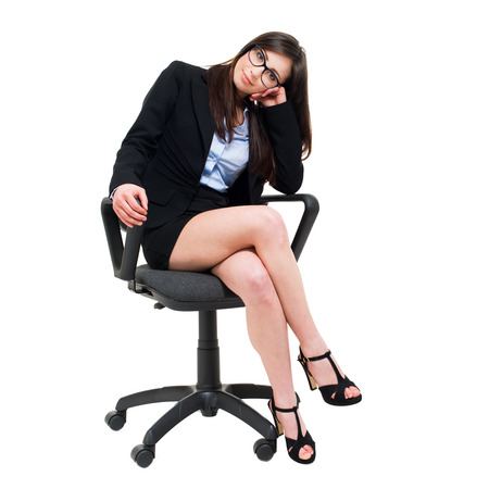 secretary: Young businesswoman sitting on a chair isolated on white