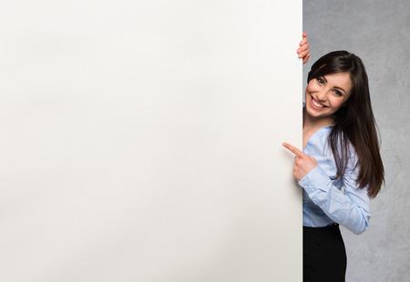 Beautiful woman showing a white board Standard-Bild