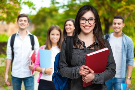 scholastic: Students in a park Stock Photo