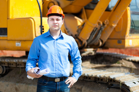 executive helmet: Smiling architect in a construction site