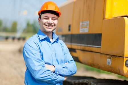 upkeep: Worker in a construction site Stock Photo