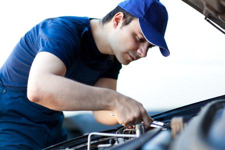 fixing: Mechanic fixing a car engine