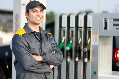 normal distribution: Smiling worker at the gas station