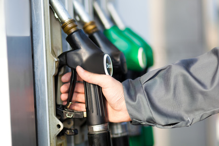 normal distribution: Man holding a fuel nozzle Stock Photo
