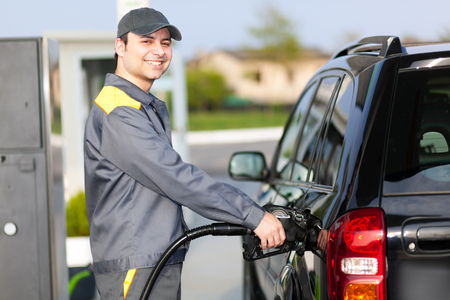 normal distribution: Gas station attendant at work