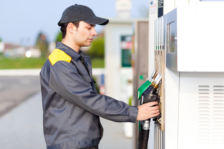 normal distribution: Worker at the gas station Stock Photo