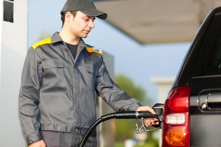 litre: Smiling worker at the gas station