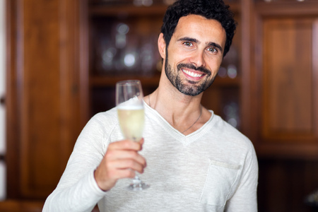 birthday suit: Man drinking champagne in his living room