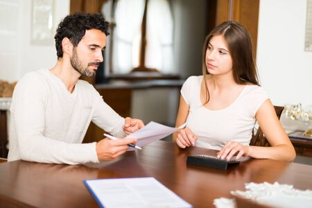 monthly salary: Couple calculating their expenses together Stock Photo