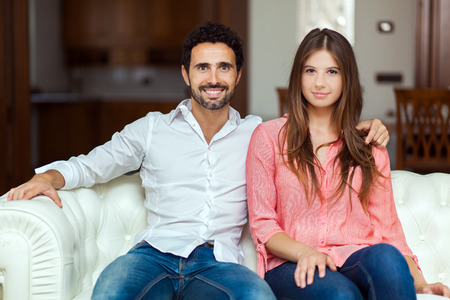 Young couple on the sofa in love Stock Photo