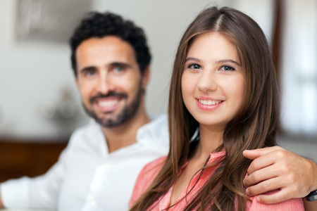 loving couples: Young couple on the sofa in love Stock Photo