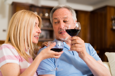 zinfandel: Portrait of a mature couple drinking a glass of red wine
