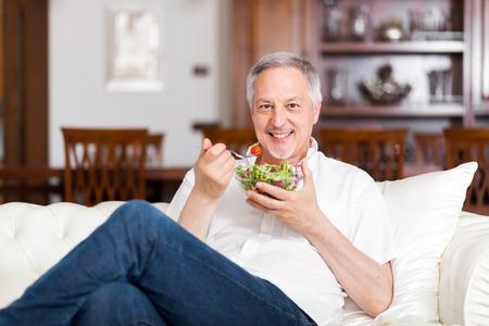 eating salad: Man eating a salad
