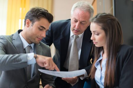 firm: Business people at work in their office Stock Photo