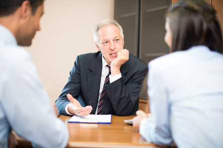 hire: Businessman talking to a young couple