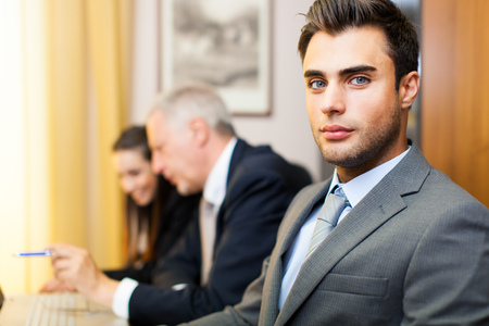 young group: Businesspeople in their office Stock Photo