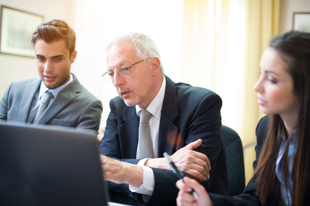 Business people at work in their office Stock Photo