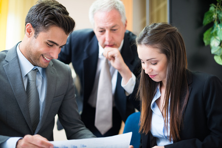 senior business: Business people at work in their office Stock Photo
