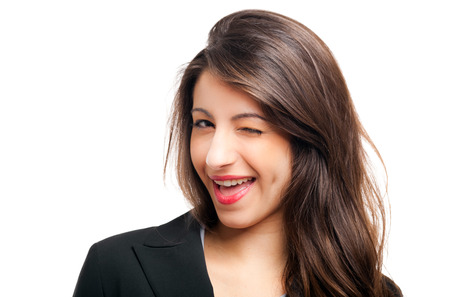 Young woman winking at you Stock Photo