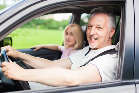 Mature couple traveling in their car Stock Photo