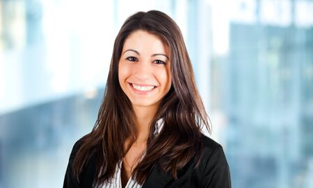 young woman smiling: Smiling young business woman Stock Photo