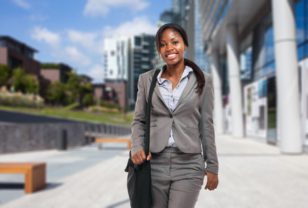 Black businesswoman holding a briefcase outdoor