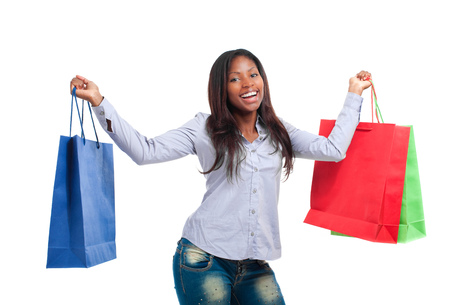 compras compulsivas: Hermosa mujer de negro sonriente y con bolsas de la compra Foto de archivo