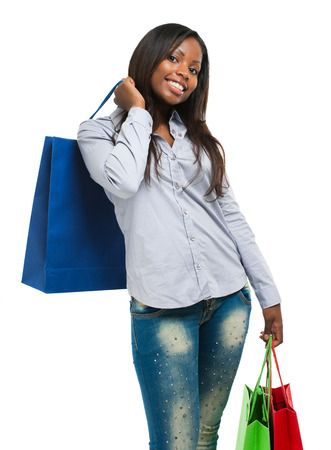 beautiful black woman: Beautiful black woman smiling and holding shopping bags