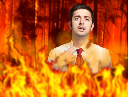 Businessman in flames: stressed by troubles Stock Photo