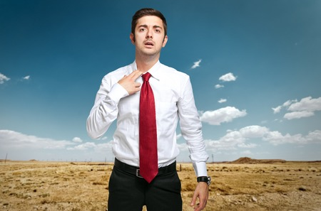 dismissed: Fired businessman sweating in the desert Stock Photo