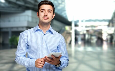 young businessman: Young man using his tablet Stock Photo