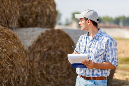 prongs: Farmer writing on a clipboard