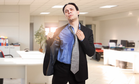 Sweating businessman due to hot climate 免版税图像 - 73369887