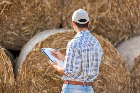 hayfork: Farmer working in his field Stock Photo