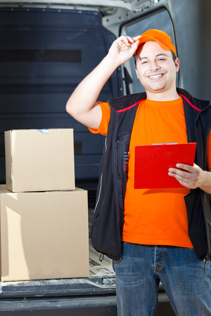 consign: Young delivery man portrait