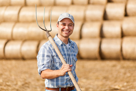 Farmer holding a pitchfork Stock Photo