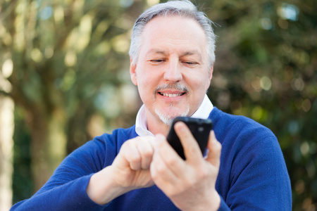 Portrait of a mature man using a mobile phone photo