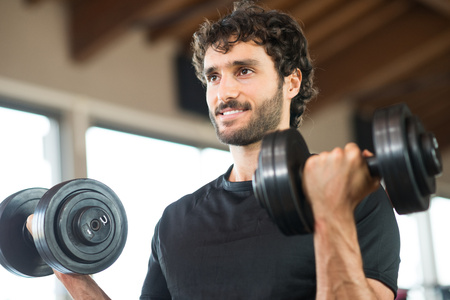 weight lifter: Man working out in a gym