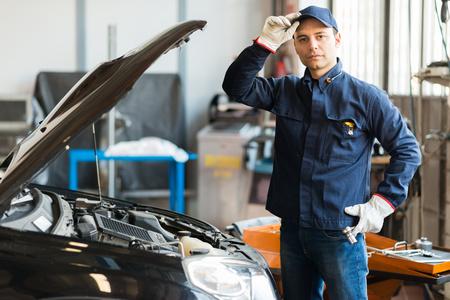 Portrait of a mechanic in his shop photo