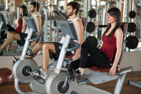 Group of people working out on a stationary bike photo