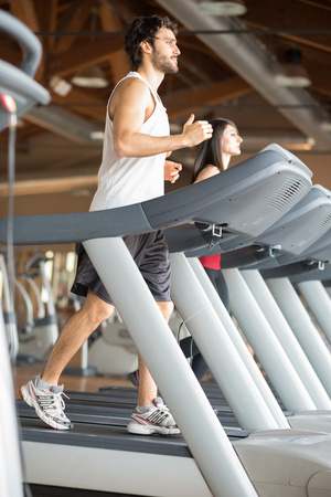 People working out on treadmills in a gym photo