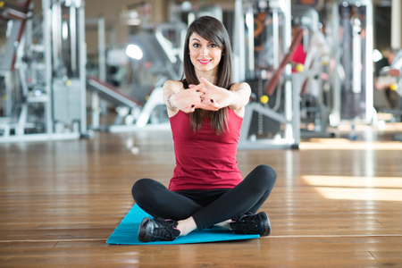 Woman doing stretching in a gym photo